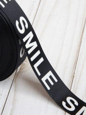 ЧЁРНАЯ РЕПСОВАЯ ЛЕНТА С БЕЛЫМ ТЕКСТОМ «Smile» 20 мм х 23±1 м